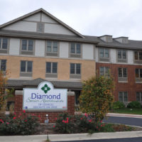 Diamond Senior Apartments of Oswego Sign